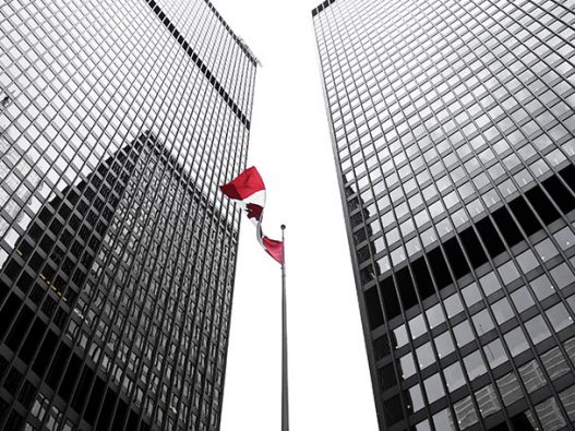 Canadian flag and skyscrapers